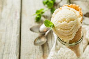 Vanilla ice cream in waffle cone, copy space